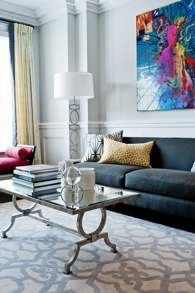 Living room with inverted pleat drapery panels and custom cushions